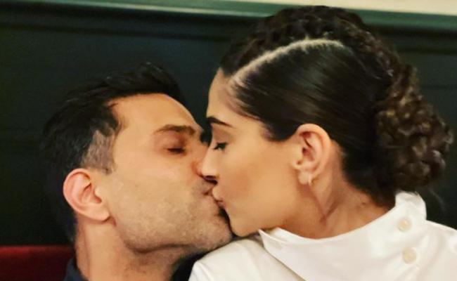Sonam Kapoor, Anand Ahuja Ready To Take On 2021 With Kiss - Sakshi