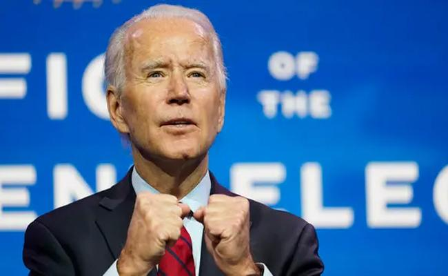 Joe Biden Unveils Emergency Coronavirus ANd Stimulus Plan - Sakshi