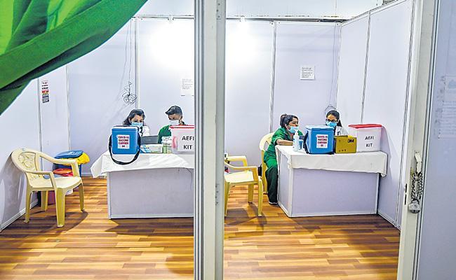 PM Narendra Modi set to launch world largest Covid-19 vaccination drive - Sakshi
