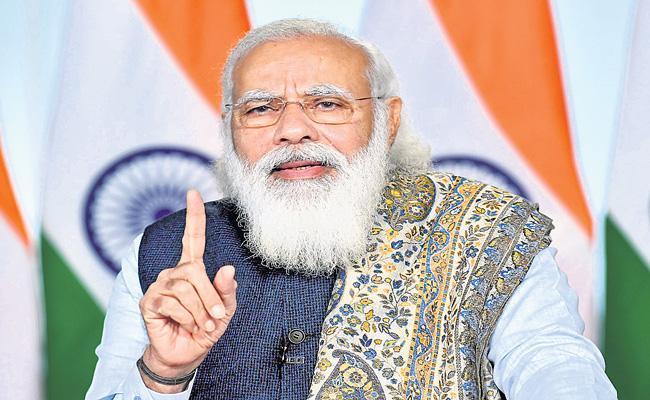 PM Narendra Modi launches world biggest vaccination drive - Sakshi