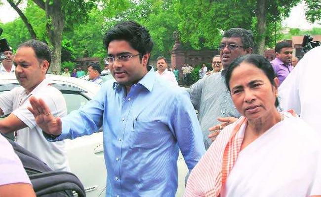 Trinamool leader Abhishek Banerjee sends legal notice to BJP's Suvendu Adhikari For Making Defamatory Statements - Sakshi