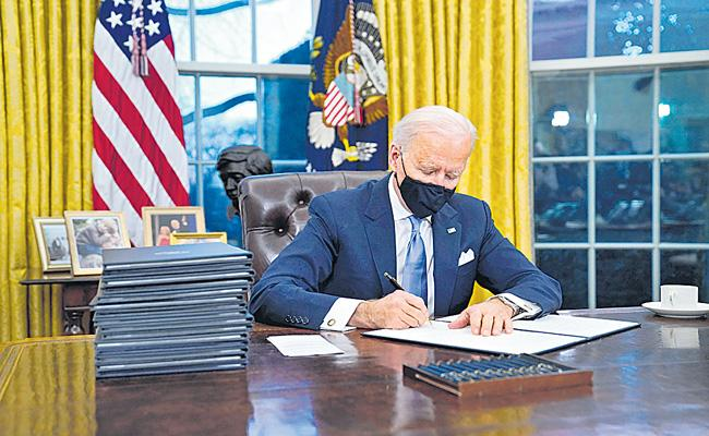 USA President Joe Biden lays out busy first day in office - Sakshi