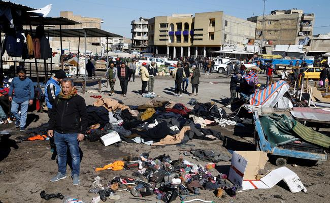 Twin suicide bombings kill at least 32 in Baghdad - Sakshi