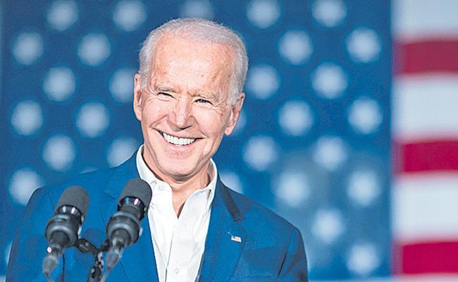 Joe Biden set to reimpose travel ban on UK and EU - Sakshi