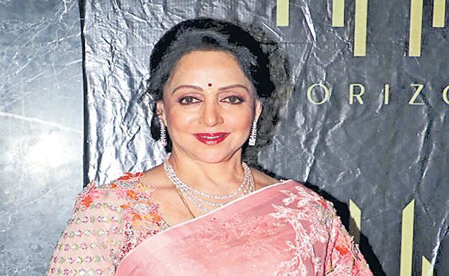 Hema Malini Playing Key role in Prabhas movie - Sakshi