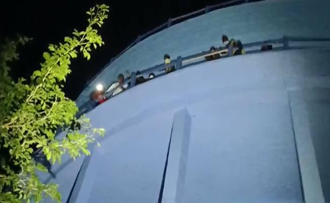 Men Climbed Water Tank To Protest Over Loan Repayment From A Woman - Sakshi