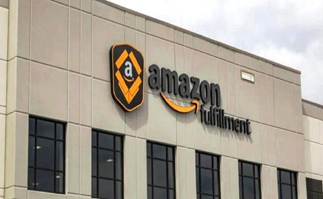 CAIT Seeks Ban on Amazon in India - Sakshi