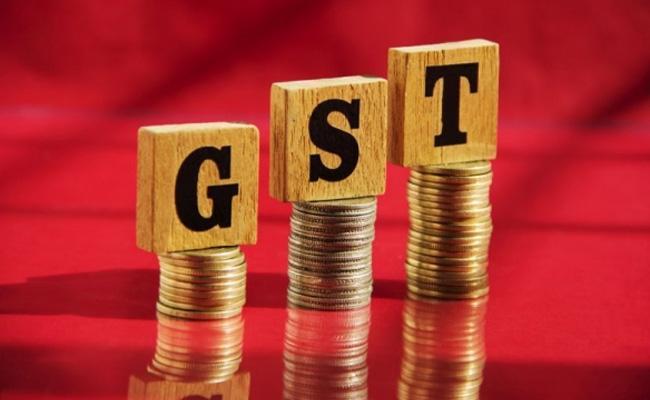 Central Government Backs Merger of 2 Tax Slabs in GST - Sakshi