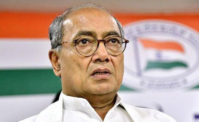 non bailable warrant Against digvijay singh - Sakshi