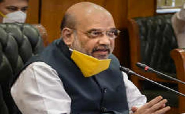 Union Home Minister Amit Shah on Monday reviewed the COVID-19 situation - Sakshi