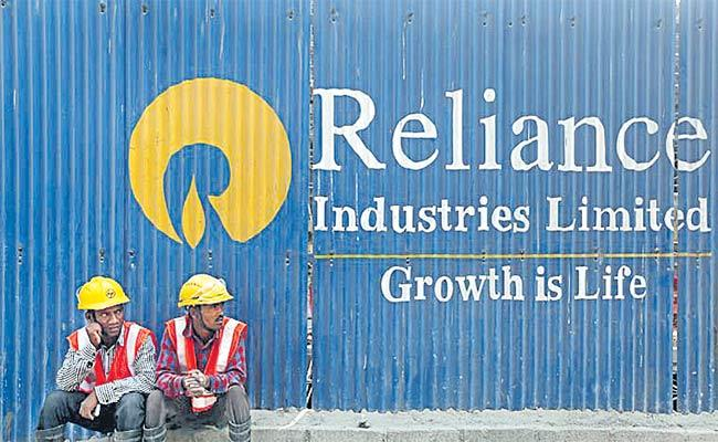 Reliance Industries Hives Off Oil To Chemical Business - Sakshi