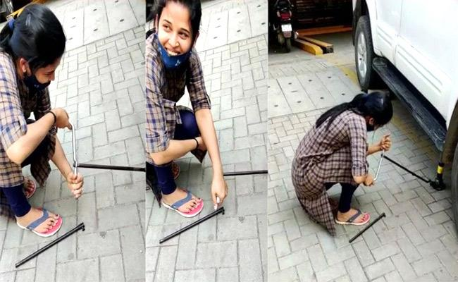 Mysore District Collector Rohini Sindhuri Replace Car Tyre On Her Own - Sakshi