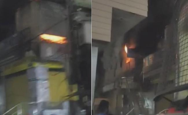 Fire Accident At Sanitary Shop In Abids Troop Bazar - Sakshi