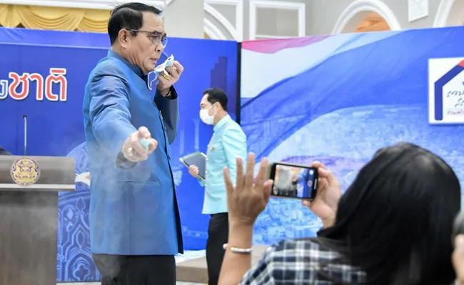 Thailand PM Sprays Reporters With Hand Sanitiser - Sakshi