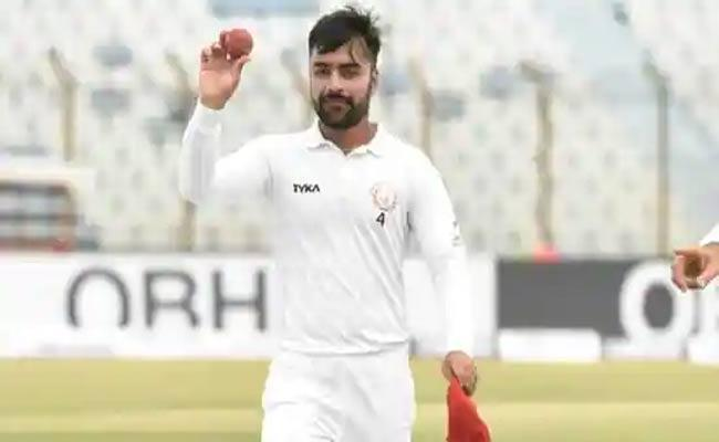 Afghanistan Spinner Rashid Khan Creates Record For Bowling Most Number Of Overs In Single Test Match In 21st Century - Sakshi