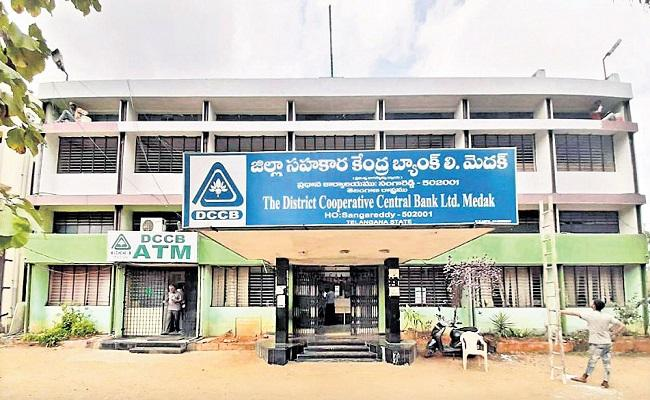 Medak Co Operative Society Officials Flexi Set Up Names and Photos of Farmers Not Paid Loans - Sakshi