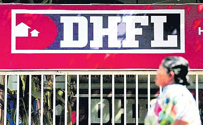 DHFL booked for creating 2.60 lakh fake home loan accounts under PMAY - Sakshi