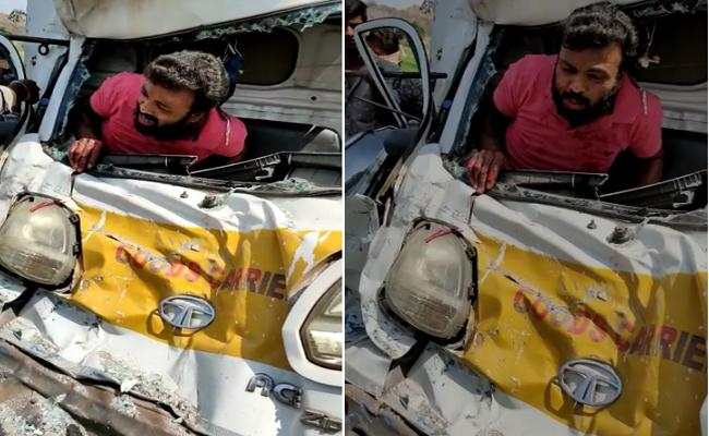 Young Man Stucked In Cabin Of Tata Ace In A Accident In Karimnagar - Sakshi