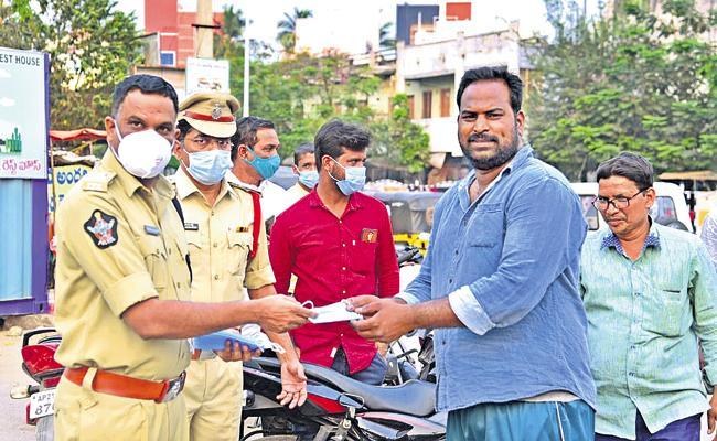 AP Police war on Corona again - Sakshi