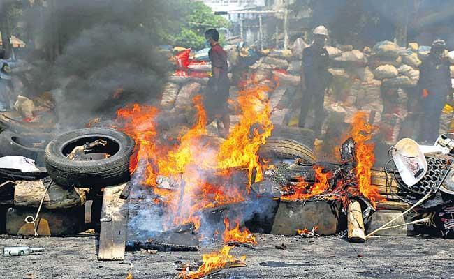 Myanmar military fighter jets bomb village civilians killed - Sakshi