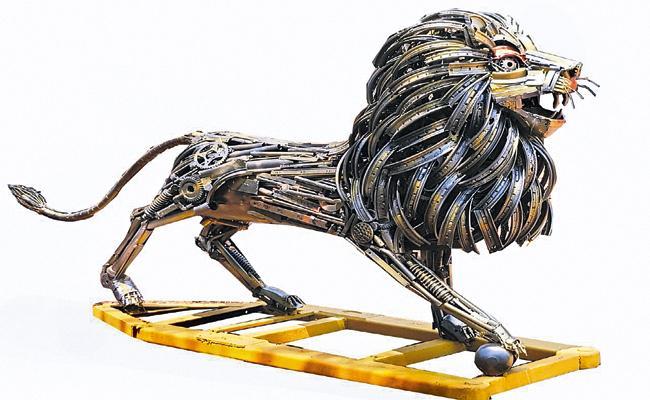 Automobile waste as beautiful sculptures - Sakshi