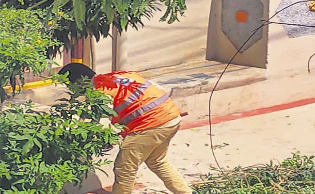 Municipal Officer Criticized For Sanitation Staff Work House Hayathnagar - Sakshi