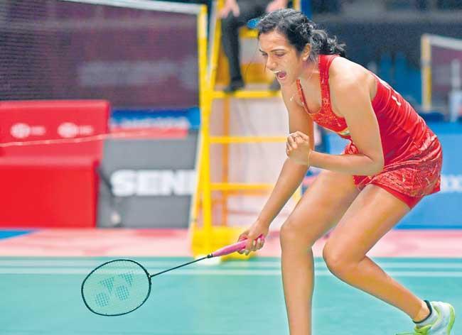 PV Sindhu sets up blockbuster final against Carolina Marin - Sakshi