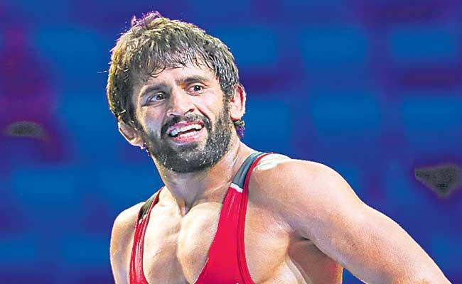 Bajrang Punia wins gold at Rome Ranking Series wrestling - Sakshi