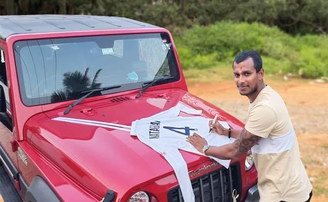 Natarajan Thanks Anand Mahindra For Gifting SUV, Sends His Signed Debut Test Shirt In Return - Sakshi