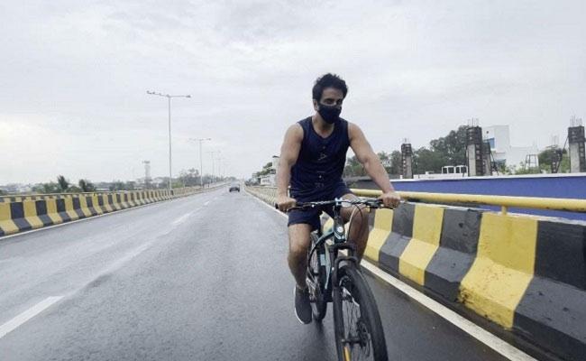 Sonu Sood Cycling To Join Sets Of Acharya Movie Shoot - Sakshi