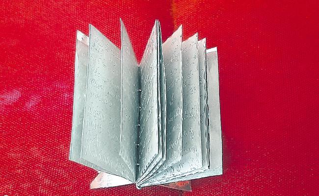 Hanuman Chalisa in the Subtle silver book - Sakshi