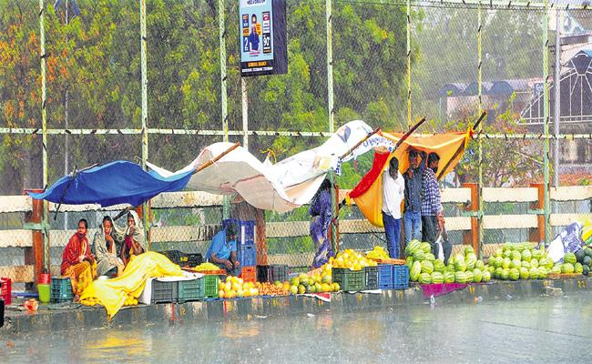 Rained with gusts on Friday evening in several places across AP - Sakshi