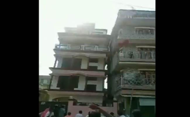 Assam earth quake A building tilts adjacent building in Nagaon - Sakshi
