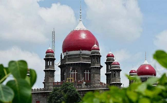 Telangana  courts puts physical hearings on hold due to surge in Corona cases - Sakshi