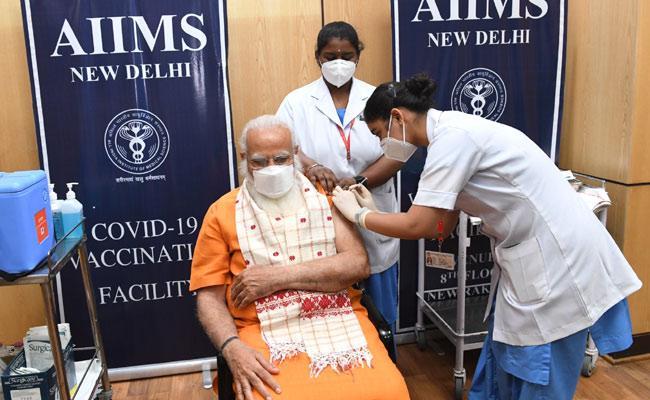 PM Narendra Modi Takes 2nd Dose Of Covid Vaccine At AIIMS - Sakshi