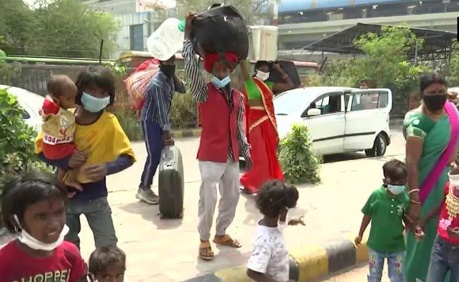 Re Return: Migrant Workers Leaving From Mumbai, Delhi - Sakshi