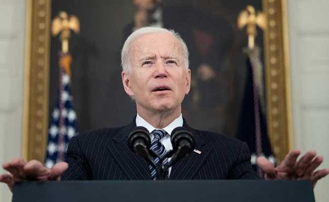 Joe Biden makes all adults in US eligible for Covid vaccination - Sakshi