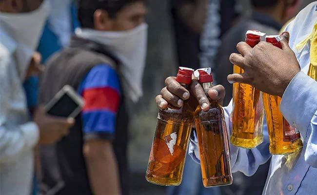 Chhattisgarh Begins Online Booking And Home Delivery Of Liquor - Sakshi