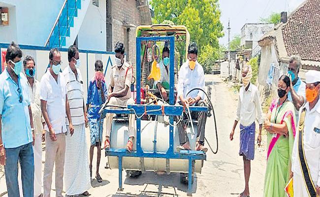 Sodium hypochlorite spray in villages - Sakshi