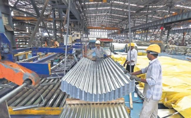 Industrial Production Grows 22 4 pc In March - Sakshi
