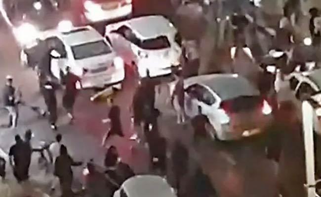 Israeli Mob Attack On Arab Man Live On Kan TV - Sakshi