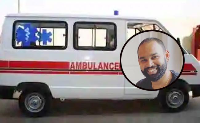 Telangana: NRI turns ambulance driver to ferry Covid-19 patients - Sakshi