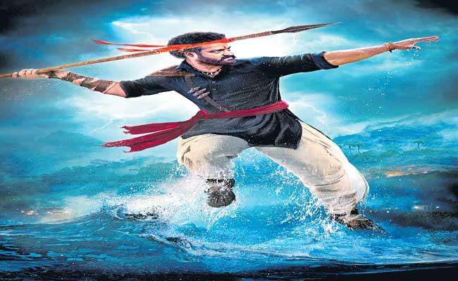 Jn NTR RRR Movie New Poster Release - Sakshi