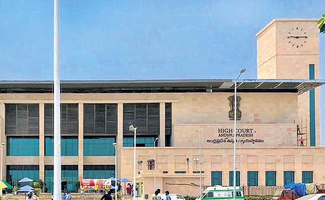 Give interim bail to prisoners says AP High Court - Sakshi