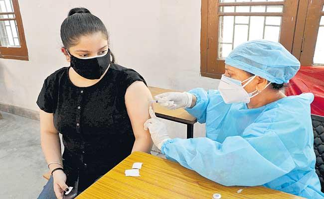 Why is Covid-19 vaccine given in arms - Sakshi