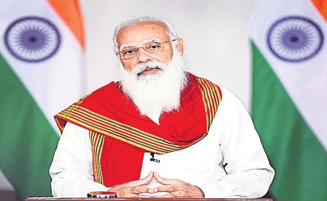 PM Narendra Modi to address Virtual Vesak Global Celebrations - Sakshi
