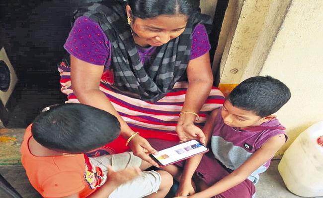 Teaching Anganwadi Children In Online - Sakshi