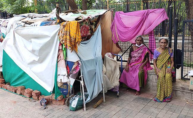 Old People Live At Footpath At Basavatarakam Cancer Hospital KBR Park - Sakshi