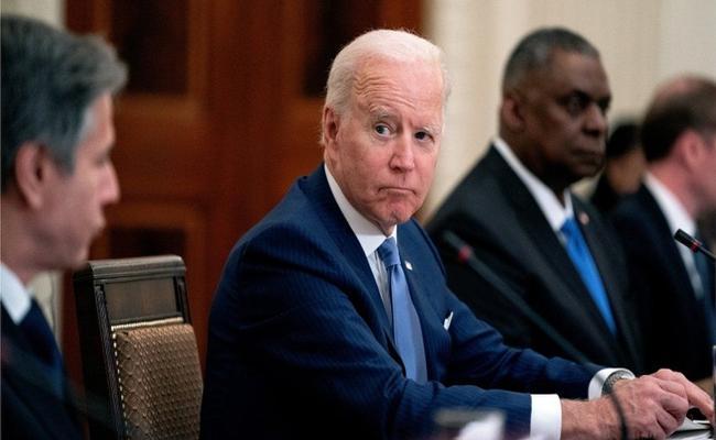 Joe Biden orders investigation into virus origin as lab leak theory debated - Sakshi