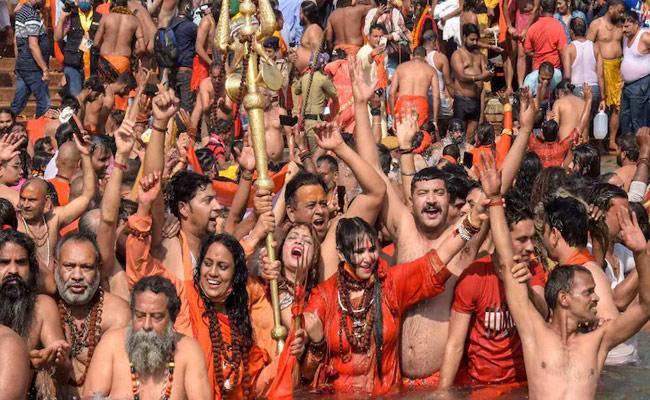 Kumbh Mela Top Official Says Unfair To Call Kumbh Mela Covid Super Spreader - Sakshi